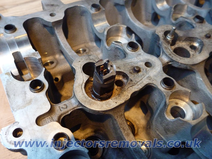 Snapped and welded injector removed from